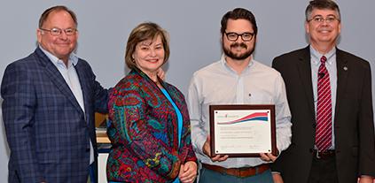 Professorship award winner, donors, and Chancellor