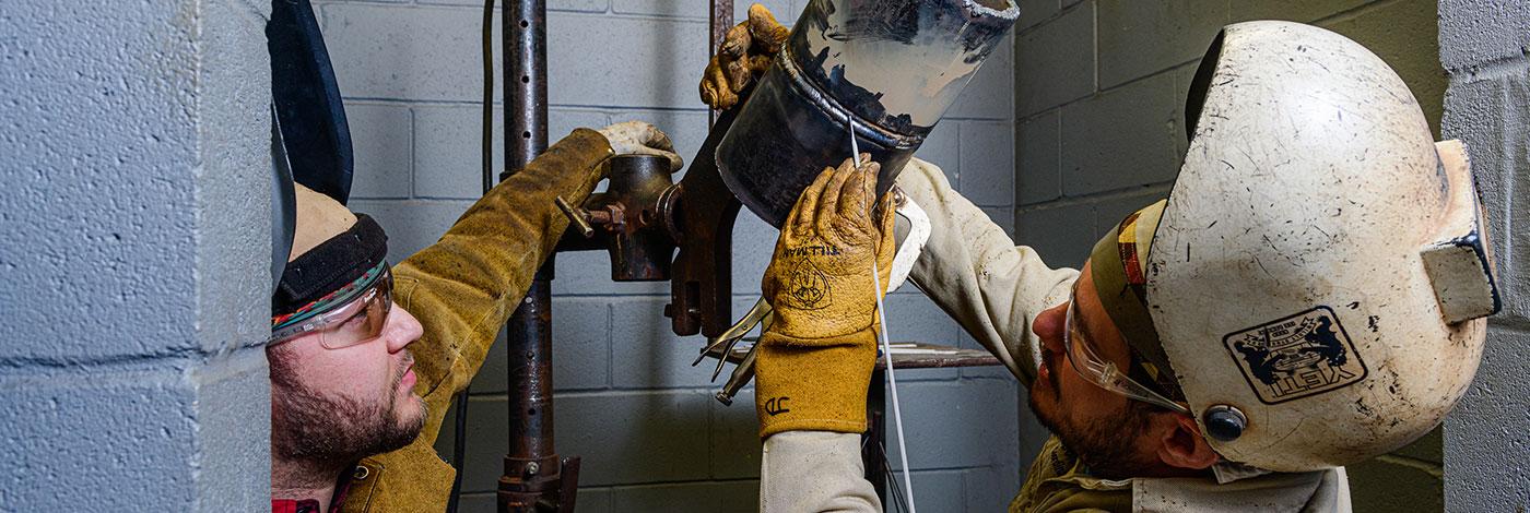 Image of student welding